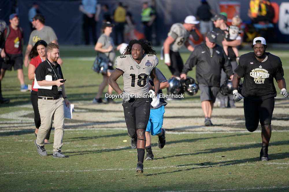 Central Florida linebacker Shaquem Griffin (18) celebrates on the field after the American Athletic Conference championship NCAA college football game against Memphis Saturday, Dec. 2, 2017, in Orlando, Fla. Central Florida won 62-55. (Photo by Phelan M. Ebenhack)