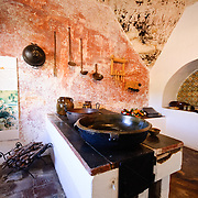 An exhibit demonstrating historic traditional kitchen at a museum at Casa Santo Domingo, a hotel built amongst the ruins of a former monastery. Famous for its well-preserved Spanish baroque architecture as well as a number of ruins from earthquakes, Antigua Guatemala is a UNESCO World Heritage Site and former capital of Guatemala.