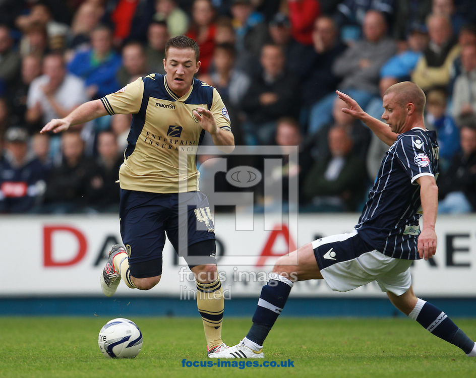 Picture by John Rainford/Focus Images Ltd +44 7506 538356<br /> 28/09/2013<br /> Alan Dunne of Millwall and Ross McCormack of Leeds United during the Sky Bet Championship match at The Den, London.