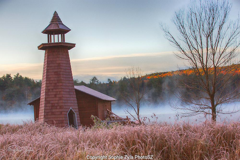 Lighthouse and Morning Mist on Lake Morey