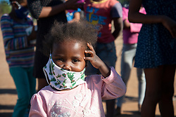 A small child wearing a facemask is seen at a volunteer food drive in Mountain View, an informal settlement in Jamestown, located in the Cape Winelands District, on Saturday, May 29, 2020. It's estimated that most, if not all, of the households here had no income, due to unemployement during lockdown. Cape Winelands is one of the districts in the Western Cape that has been designated a hotspot area, in terms of people testing positive for COVID-19. When South Africa moves down to Stage 3 of the nationwide lockdown on June 1st, hotspots areas will remain under stricter regulation and surveillance, per the latest government announcements. PHOTO: EVA-LOTTA JANSSON