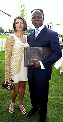 MR & MRS CHRIS EUBANK, he is the former World champion boxer, at a polo match in Berkshire on 30th July 2000.OGN 194