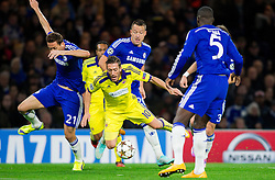 Agim Ibraimi of Maribor faulted for penalty shot by Nemanja Matić of Chelsea during football match between Chelsea FC and NK Maribor, SLO in Group G of Group Stage of UEFA Champions League 2014/15, on October 21, 2014 in Stamford Bridge Stadium, London, Great Britain. Photo by Vid Ponikvar / Sportida.com