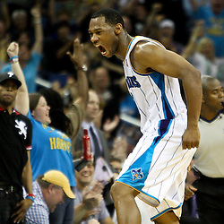 April 8, 2011; New Orleans, LA, USA; New Orleans Hornets shooting guard Willie Green (33) celebrates after scoring during the fourth quarter against the Phoenix Suns at the New Orleans Arena. The Hornets defeated the Suns 109-97.   Mandatory Credit: Derick E. Hingle
