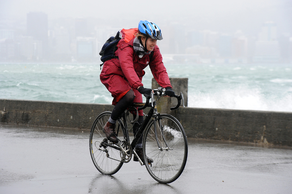 A cyclist takes on the weather on Oriental Parade as high winds lash the capital, Wellington, New Zealand, Monday, October 14, 2013. Credit:SNPA / Ross Setford