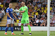 Burton Albion goalkeeper Kieran O'Hara and Ipswich Town midfielder Danny Rowe challenge during the EFL Sky Bet League 1 match between Burton Albion and Ipswich Town at the Pirelli Stadium, Burton upon Trent, England on 3 August 2019.