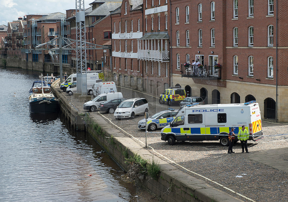 © Licensed to London News Pictures. 10/07/2016. <br /> Emergency services on the banks of the River Ouse in York on Sunday 10th July 2016, wherea man seen falling from a bridge. Photo credit: Max Bryan/LNP