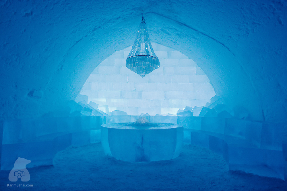 A chandelier hangs above a louge at the Icehotel in Jukkasjärvi. The room is made of ice from a nearby lake.