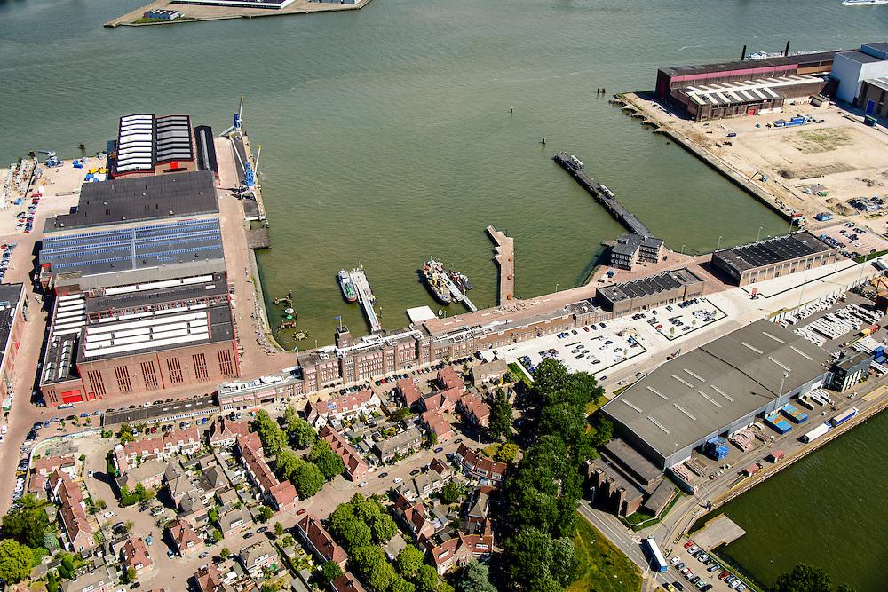 Nederland, Zuid-Holland, Rotterdam, 10-06-2015;  RDM campus, gezien vanaf Heijplaat met de Nieuw Maas in de achtergrond. Voormalige werf van de Rotterdamsche Droogdok Maatschappij (RDM) met de onderzeebootloods (linker kade, achteraan).<br />  Former shipyard of the Rotterdam Drydock Company (RDM), the submarine hangar (top left).<br /> luchtfoto (toeslag op standard tarieven);<br /> aerial photo (additional fee required);<br /> copyright foto/photo Siebe Swart