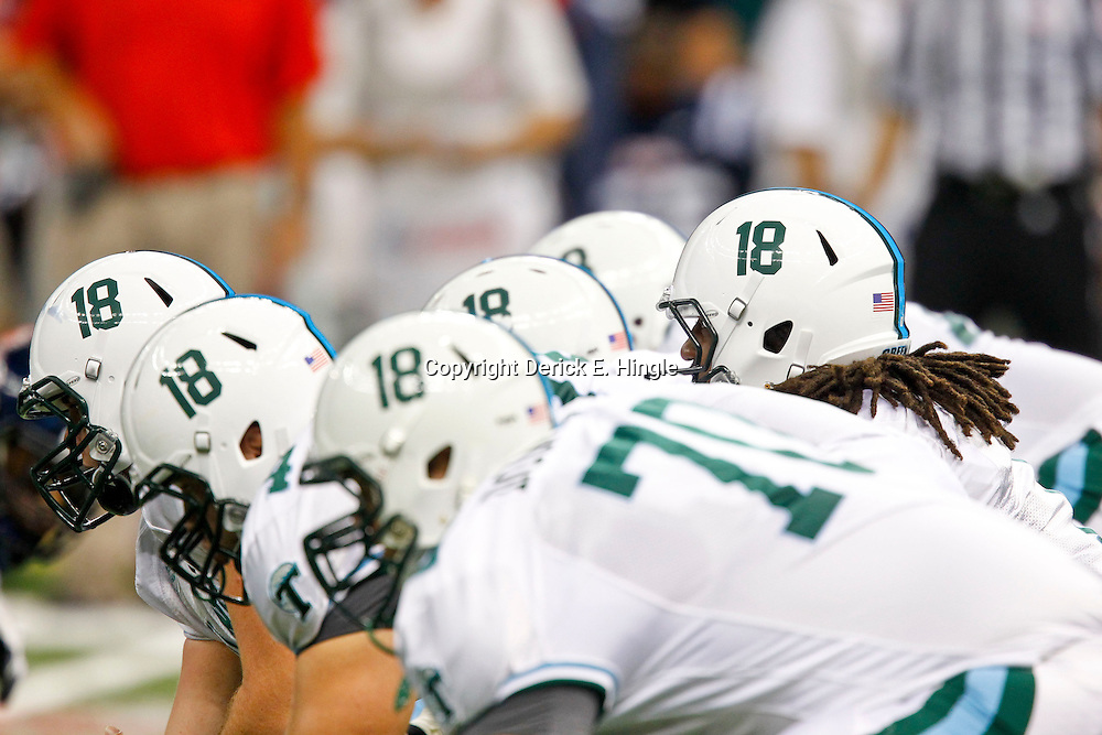 September 22, 2012; New Orleans, LA, USA; Tulane Green Wave players wear a decal in support of injured teammate safety Devon Walker (18) during a game against the Ole Miss Rebels at the Mercedes-Benz Superdome. Walker suffered a fractured spine in the collision with a teammate during the first week of the season. Mandatory Credit: Derick E. Hingle-US PRESSWIRE