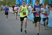 Mike Ballow, left, Dale Thomas, center, and Jeffrey Coons, right, charge to the finish at the Corporate Challenge on the campus of RIT on Tuesday, May 24, 2016.