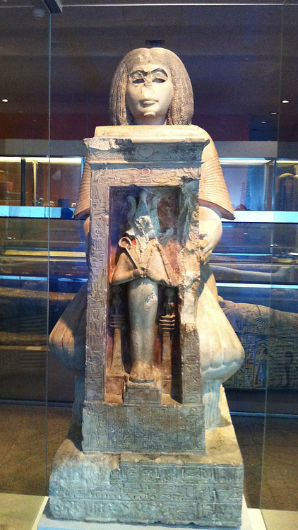 Statue of Yuny. Early 19th Dynasty circa 1294-1269 BC from Assiut, Egypt. Yuni  kneels before Osiris.