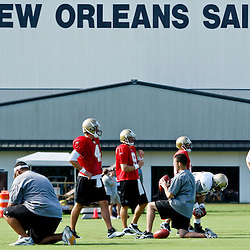 July 31, 2011; Metairie, LA, USA; New Orleans Saints quarterbacks Ryan Colburn (3), Sean Canfield (4), Drew Brees (9), and Chase Daniel (10) during training camp practice at the New Orleans Saints practice facility. Mandatory Credit: Derick E. Hingle