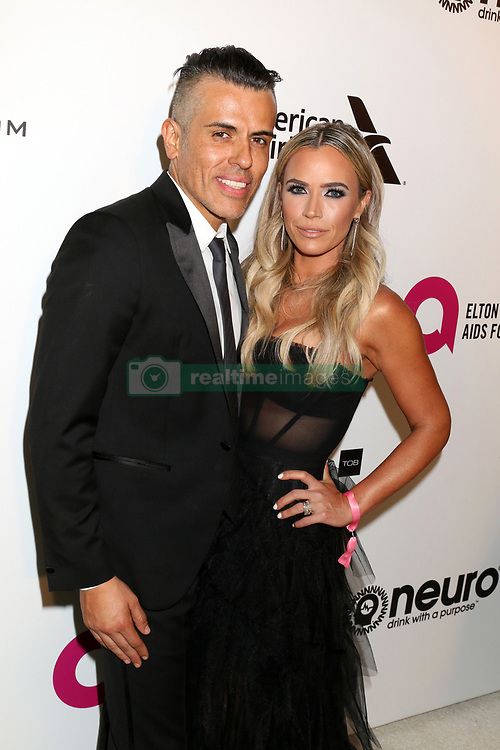 February 24, 2019 - West Hollywood, CA, USA - LOS ANGELES - FEB 24:  Edwin Arroyave, Teddi Jo Mellencamp at the Elton John Oscar Viewing Party on the West Hollywood Park on February 24, 2019 in West Hollywood, CA (Credit Image: © Kay Blake/ZUMA Wire)