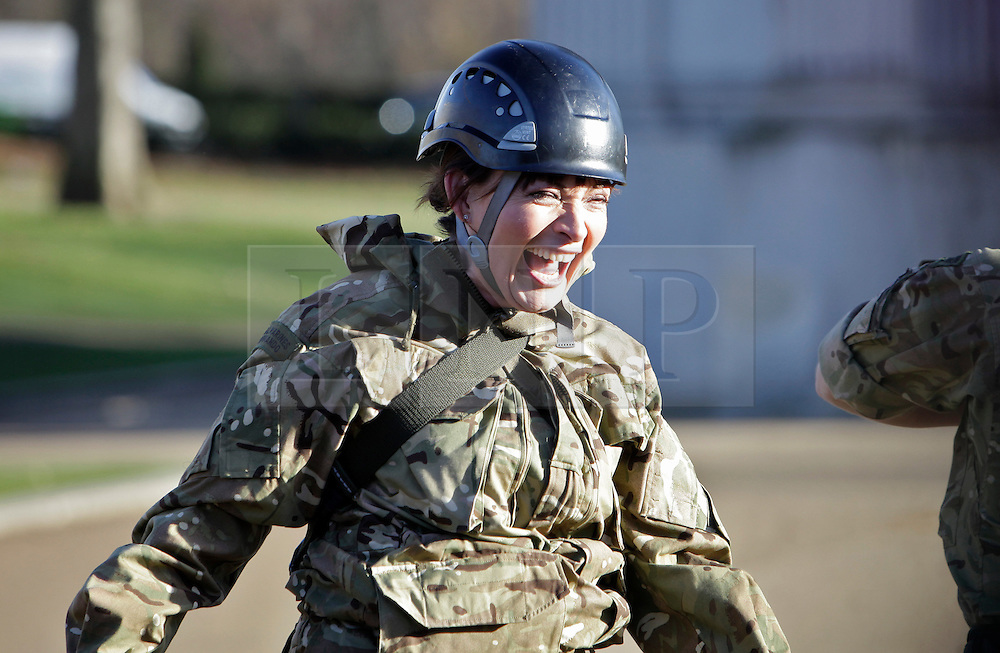 © Licensed to London News Pictures. 04/12/2012. London, U.K..Daybreak presenter Lorraine Kelly zip wires with members of the Royal Marines from wellington Arch at Hyde park corner, london this morning (4/12/12) to help launch the annual charity campaign to send Christmas Boxes to members of the armed forces around the world..Photo credit : Rich Bowen/LNP