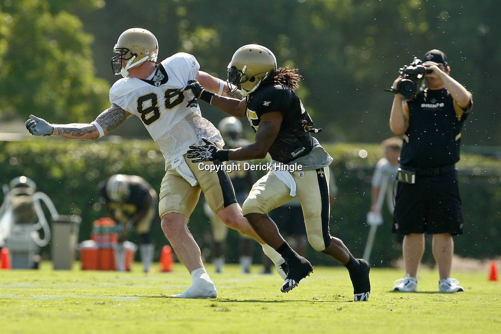 July 31, 2010; Metairie, LA, USA; New Orleans Saints cornerback Reggie Jones (35) grabs tight end Jeremy Shockey (88) on a route drill during a training camp practice at the New Orleans Saints practice facility. Mandatory Credit: Derick E. Hingle