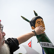 TOKYO, JAPAN - MAY 1 : An angry demonstrator covers the mouth on an effigy of Japanese PM Shinzo Abe during the May Day Rally in Tokyo, Japan on May 1, 2017. (Photo by Richard Atrero de Guzman/NUR Photo)
