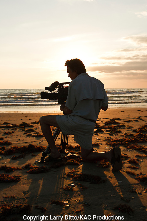 Richard Moore shooting nature video on beach at South Padre Island, Texas, USA, Gulf of Mexico, sunrise