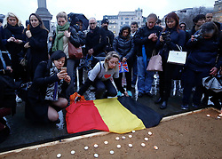 © Licensed to London News Pictures. 24/03/2016. London, UK. Mourners attending a vigil to pay tribute to Brussels terror victims in Trafalgar Square, London on Thursday, 24 March 2016. Photo credit: Tolga Akmen/LNP
