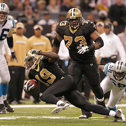 2008 December, 28: New Orleans Saints wide receiver Devery Henderson (19) tries to hold his balance after making a catch during a week 17 game between NFC South divisional rivals the Carolina Panthers and the New Orleans Saints at the Louisiana Superdome in New Orleans, LA.