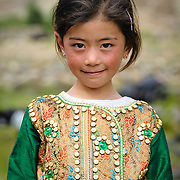 Young girl in traditional Ladakhi dress at a temple opening festival, Arzu, Ladakh, India