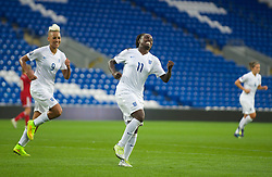 CARDIFF, WALES - Tuesday, August 21, 2014: England's Eniola Aluko celebrates scoring the second goal against Wales during the FIFA Women's World Cup Canada 2015 Qualifying Group 6 match at the Cardiff City Stadium. (Pic by Ian Cook/Propaganda)