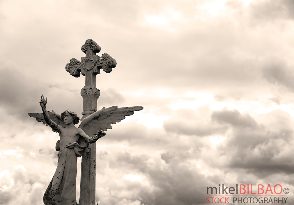Guardian angel statue in cemetery.<br /> Comillas, Cantabria, Spain, Europe
