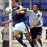 St Johnstone v Ross County..19.03.05<br />Ian Maxwell and Sean Higgins<br /><br />Picture by Graeme Hart.<br />Copyright Perthshire Picture Agency<br />Tel: 01738 623350  Mobile: 07990 594431