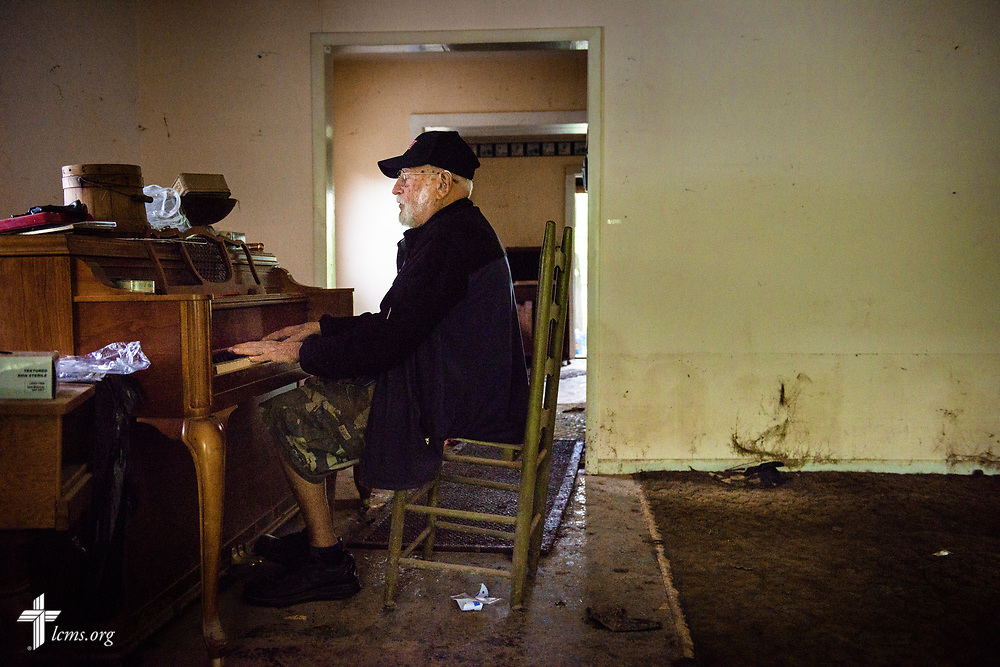 Dick Keezer, a member at First Lutheran Church, Neosho, Mo., plays one final tune in his home of over 40 years on Wednesday, May 3, 2017, in Neosho. His house was deemed a total loss from the weekend flood. Dick spoke love through his music, mourning the end, yet thankful for all that was given. LCMS Communications/Erik M. Lunsford