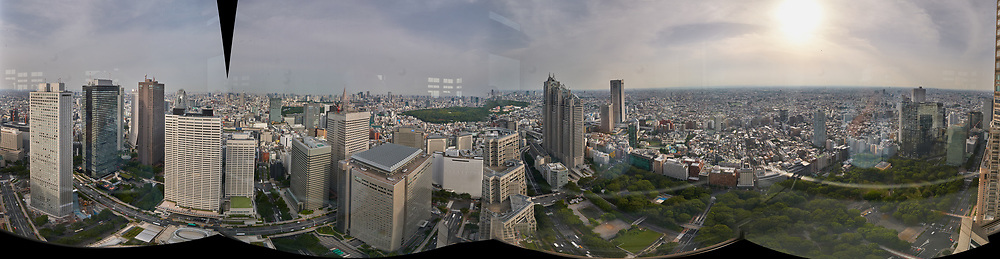 Panoramic View (360 degrees) of the Tokyo Skyline from the 47th floor South Tower Observatory in the Metropolitan Government Building. Composite of 51 images taken with a Leica CL camera and 11-23 mm lens (ISO 200, 18 mm, f/16, 1/125 sec). Raw images processed with Capture One Pro and AutoPano Giga Pro.
