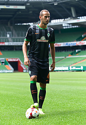 31.07.2014, Trainingsgelände am Weserstadion, Bremen, GER, 1. FBL, SV Werder Bremen Training,  im Bild Alejandro Galvez (SV Werder Bremen #4) präsentiert das neue Auswärtstrikot für die Saison 2014/2015 // during the training session on the training ground of the German Bundesliga Club SV Werder Bremen at the Weserstadion, Bremen, Germany on 2014/07/31. EXPA Pictures © 2014, PhotoCredit: EXPA/ Andreas Gumz<br /> <br /> *****ATTENTION - OUT of GER*****