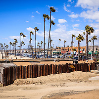Photo of Newport Beach Dory Fishing Fleet Market with 22nd Street oceanfront businesses. The Dory Fleet is a group of fisherman that operate from the Dory Fish Market by the Newport Pier and sell the catch of the day from the Pacific Ocean. The Dory Fleet is a landmark in Orange County California.