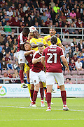 Another causes havoc in the box during the EFL Sky Bet League 1 match between Northampton Town and AFC Wimbledon at Sixfields Stadium, Northampton, England on 20 August 2016. Photo by Stuart Butcher.