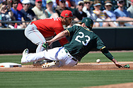 MESA, AZ - MARCH 09:  Matt Joyce #23 of the Oakland Athletics safely advances to third in front of Eugenio Suarez #7 of the Cincinnati Reds during the first inning of the spring training game at HoHoKam Stadium on March 9, 2017 in Mesa, Arizona.  (Photo by Jennifer Stewart/Getty Images)