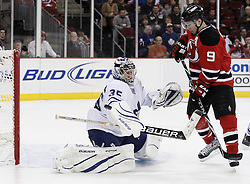 Jan 29, 2010; Newark, NJ, USA; Toronto Maple Leafs goalie Vesa Toskala (35) makes a save through a screen by New Jersey Devils left wing Zach Parise (9) during the second period at the Prudential Center.