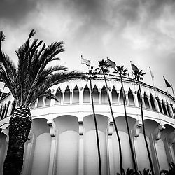 Avalon Casino Catalina Island black and white photo with dramatic cloudy sky. The Avalon Casino is a historic art deco movie theatre built in 1929 by the Wrigley family. Catalina Island is a popular travel desination off the coast of Southern California in the United States.