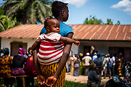 Patients wait for treatment on the first day of the LCMS Mercy Medical Team on Monday, May 7, 2018, in the Yardu village outside Koidu, Sierra Leone, West Africa. LCMS Communications/Erik M. Lunsford
