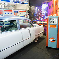 PADOVA, ITALY - OCTOBER 27:  A model wearing vintage style clothing poses next to a classic American car and petrol pump on October 27, 2011 in Padova, Italy. The Vintage and Classic Cars Exhibition of Padova, running from the October 28 - 30, is the most important European trade show for vintage cars and motorbikes, showcasing over 1600 vehicles.