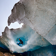 Myrna Aer poses at the edge of a tube in the Viedma Glacier near El Chalten, Argentina.