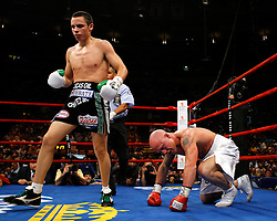 June 5, 2007; New York, NY, USA;  Julio Cesar Chavez Jr. (black trunks) knocks down Grover Wiley (white trunks) during their 10 round bout at Madison Square Garden in New York City.
