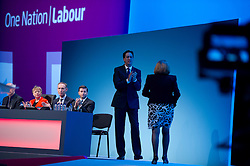 © London News Pictures. 23/09/2013 . Brighton, UK.  Leader of the Labour Party ED MILIBAND (centre) on stage on day two of the Labour Party Annual Conference in Brighton. Photo credit : Ben Cawthra/LNP
