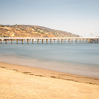 Malibu Pier at Surfrider Beach panorama photo in Malibu California. Malibu is a beach city along the Pacific Ocean in the Western United States