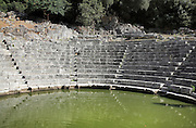 Seating auditorium of the Roman theatre, 2nd century AD, with stage building, built over an earlier 4th century BC Greek theatre, Butrint, Chaonia, Albania. Butrint was founded by the Greek Chaonian tribe and was a port throughout Hellenistic and Roman times, when it was known as Buthrotum. It was ruled by the Byzantines and the Venetians and finally abandoned in the Middle Ages. The ruins at Butrint were listed as a UNESCO World Heritage Site in 1992. Picture by Manuel Cohen