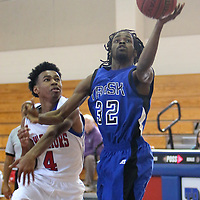 Trask's Marcus Porter shoots over Alamance's Tim Clay during the championship game of the Trask Holiday Tournament. (Jason A. Frizzelle)