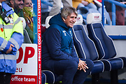 Manuel Pellegrini of West Ham United all smiles before the Premier League match between Huddersfield Town and West Ham United at the John Smiths Stadium, Huddersfield, England on 10 November 2018.