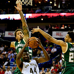 Nov 1, 2016; New Orleans, LA, USA; New Orleans Pelicans forward Solomon Hill (44) is defended by Milwaukee Bucks forward Michael Beasley (9) and guard Rashad Vaughn (20) during the second half of a game at the Smoothie King Center. Mandatory Credit: Derick E. Hingle-USA TODAY Sports