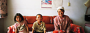 Woman  & children in  their House at Guancai  Village. Ningxia Province, China.