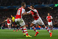 Jack Wilshere of Arsenal congratulates Alexis Sanchez of Arsenal on scoring the opening goal against Besiktas J.K. during the UEFA Champions League match at the Emirates Stadium, London<br /> Picture by David Horn/Focus Images Ltd +44 7545 970036<br /> 27/08/2014