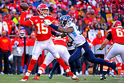 Jan 19, 2020; Kansas City, Missouri, USA; Kansas City Chiefs quarterback Patrick Mahomes (15) throws a pass against Tennessee Titans linebacker Derick Roberson (50) during the first half in the AFC Championship Game at Arrowhead Stadium. Mandatory Credit: Denny Medley-USA TODAY Sports