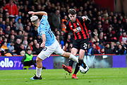 Jack Simpson (25) of AFC Bournemouth takes on Sergio Aguero (10) of Manchester City during the Premier League match between Bournemouth and Manchester City at the Vitality Stadium, Bournemouth, England on 2 March 2019.